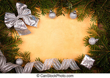 Rustic paper with silver Christmas decorations