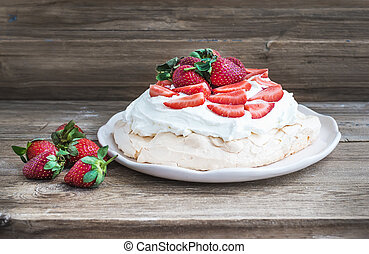 Rustic Pavlova cake with fresh strawberries and whipped ...