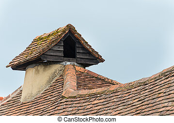 Rustic pigeon loft on roof of traditional English village...