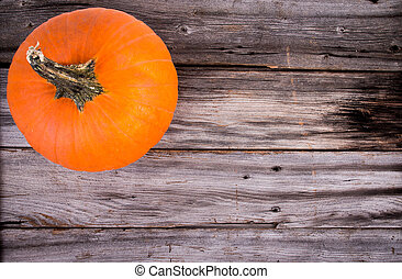 rustic pumpkin on wood