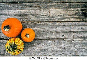 rustic pumpkins on wood high angle view