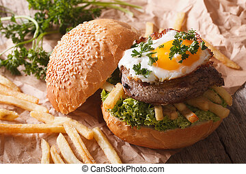 Rustic sandwich with beefsteak, fried egg and potatoes....