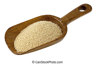 rustic scoop of amaranth grain - amaranth grain on a rustic...