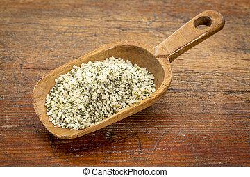 scoop of hemp seed hearts - rustic scoop of hemp seed hearts...