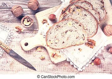 Rustic setting with fresh walnut and hazelnut bread slices