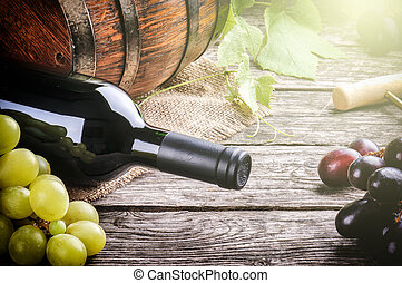 Rustic setting with red wine and fresh grape - Rustic...