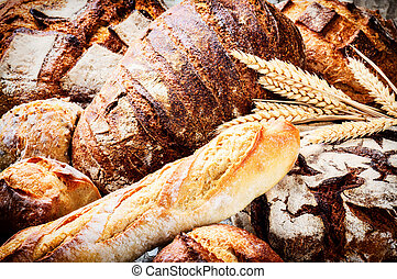 Rustic setting with various fresh bread