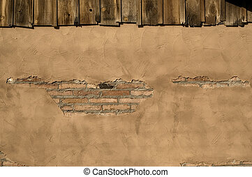 Rustic Stucco - Rustic stucco building wall with exposed...