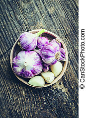 Rustic style garlic on vintage wooden background