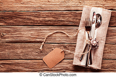 Rustic Table Setting with Cutlery and Blank Tag