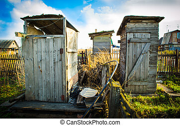 rustic toilets at their summer cottage