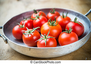 Rustic tomatoes in a metal skillet