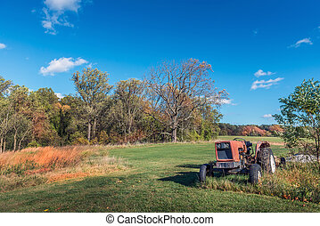 Rustic tractor in a field on a Maryland Farm during Autumn