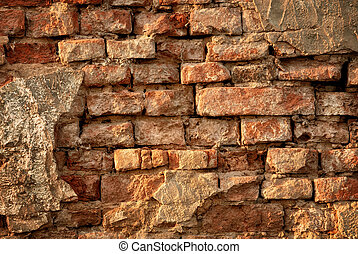 Rustic vintage brick wall in warm sunlight as a texture or...