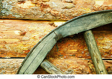 rustic wagon wheel hanging on a wall