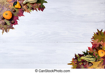 Rustic white wooden boards with autumn decorations in corners