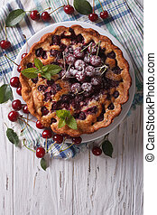 Rustic whole cherry pie vertical top view