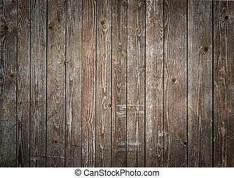 Rustic wood planks background with nice studio lighting and elegant vignetting to draw the attention.