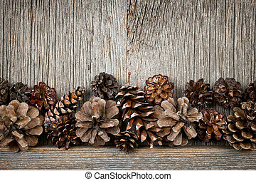 Rustic wood with pine cones