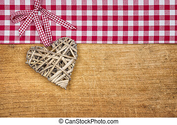 Rustic wooden background with a braided heart