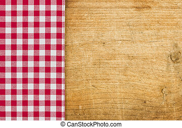 Rustic wooden background with a red checkered tablecloth