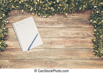 wooden background with notebook and pen