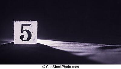 Rustic wooden block with number 5 - five - dark background