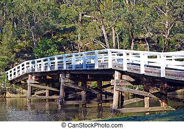 Rustic wooden bridge over river - Historic wooden Varney ...