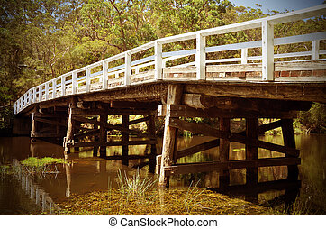Rustic wooden bridge over river in forest - Historic wooden ...