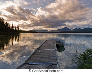 Rustic wooden float dock jetty boat tranquil lake