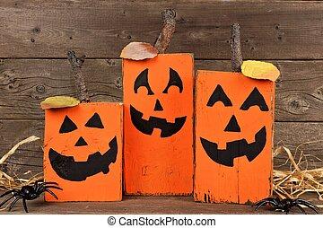 Rustic wooden Halloween Jack o Lanterns