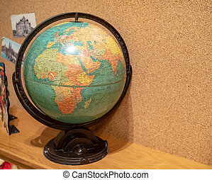 Rustic world globe displaying Africa and Europe in a child's room