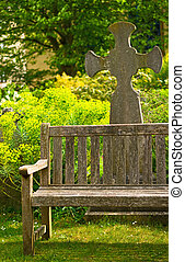 Rustical bench in blossom graveyard