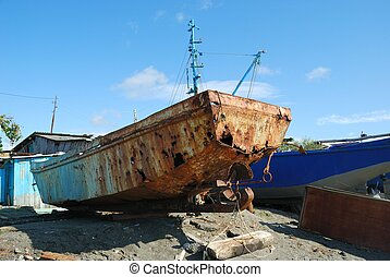 Rusting boat on the beach
