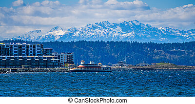 A view of the waterfront in Ruston, Washington with the Oympic Mountains in the distance.