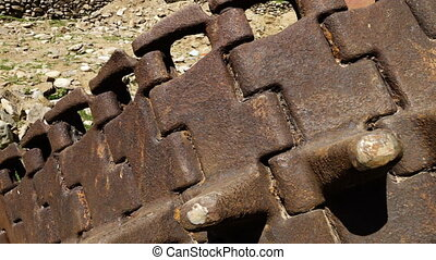 Rusty, abandoned tank tracks - A hand held, tilting, extreme...