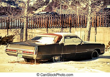 Rusty American Classic Car Abandoned Somewhere in Colorado, USA. Junk Car Under Snow.
