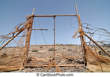 Rusty Ancien Gate over the Desert, in Canary Islands, Spain