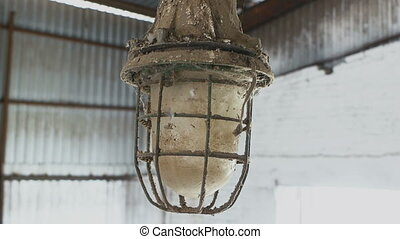 rusty and dusty lantern covered in spider web - rusty and...