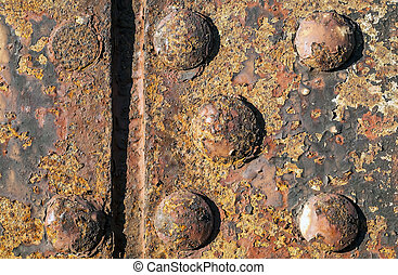 Rusty background with bolts