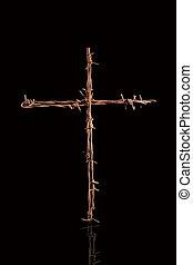 Rusty barbwire cross.