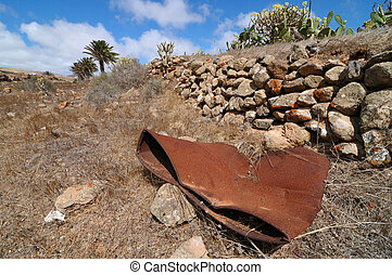 Rusty barrel in the desert