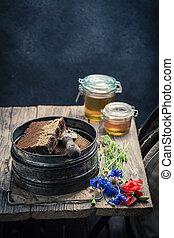 Rusty beekeeper tools in workshop with honey