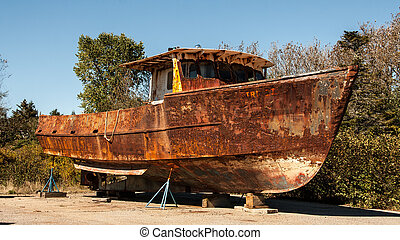 Old weathered lobster boat in Maine in the United States of America