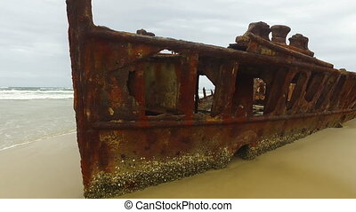 Rusty boat on shore