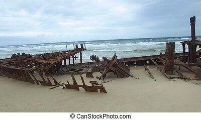 Rusty boat washed up on shore