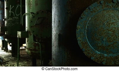 Rusty boilers in the abandoned factory. Smooth and slow dolly shot