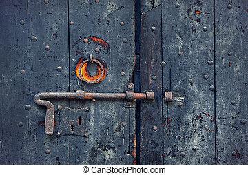 Rusty bolt on old wooden door.