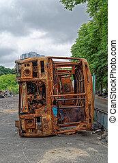rusty bus - Abandoned and rusty bus with gray sky and clouds