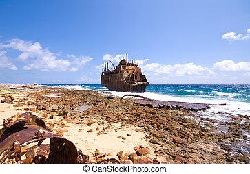caribbean shipwreck - rusty caribbean shipwreck washing...